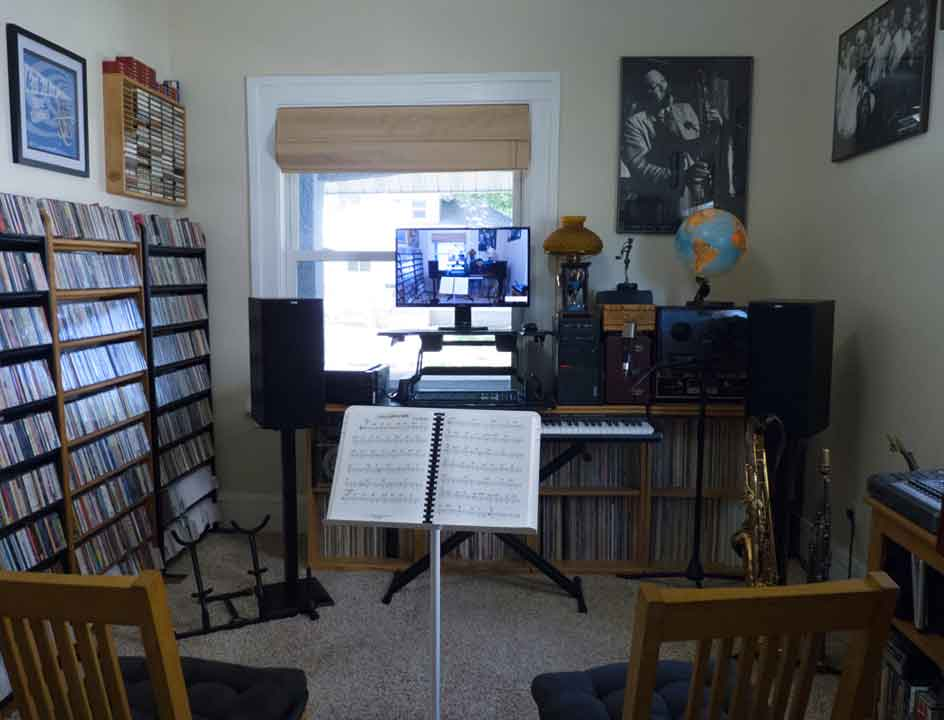 Saxophone lessons area with music book on stand for private sax lessons in Davenport, IA